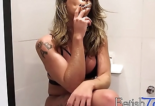 Sensual tranny likes to smoke while hotheaded herself solo