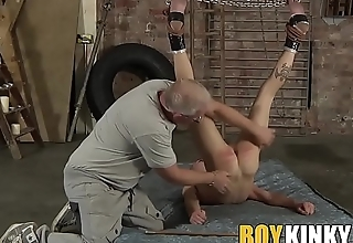 Suspended twink gets his butt cheeks red by master Sebastian