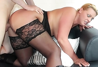 REIFE SWINGER - Curvy German blonde in stockings boned