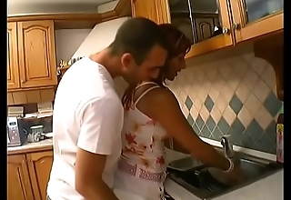 Young brace licks  and drills brunettes wringing wet pussy on kitchen counter
