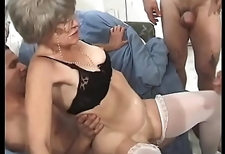 Horny granny Kathy Jones knows pretty well how to handle gang bang