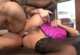 Slutty brunette Raylene gaggles on a fat cock on couch
